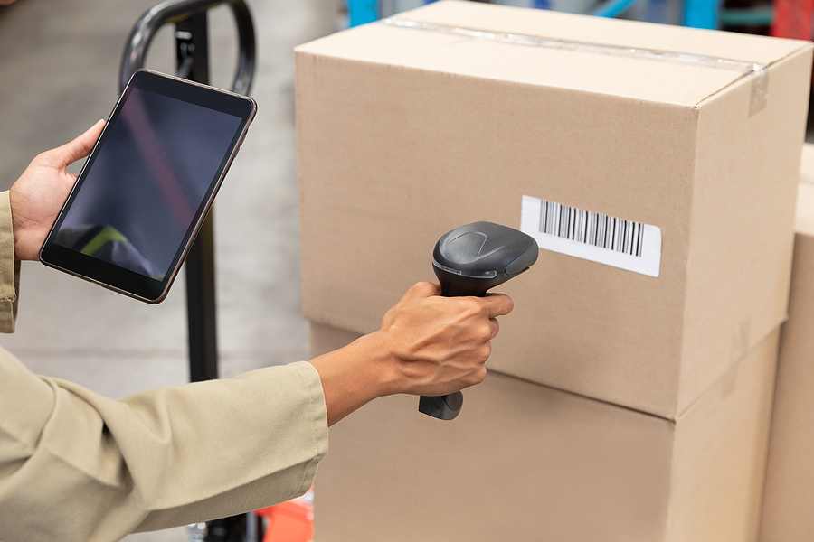 Worker scanning packages with a barcode scanner