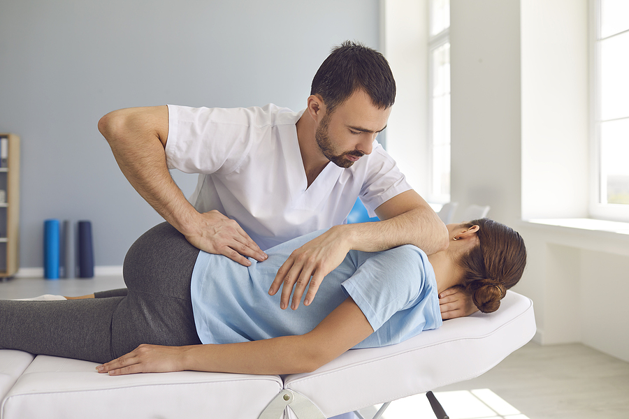Chiropractor Castle Hill treating a female patient's back